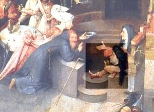"""Una testa con gambe con turbante siede con disinvoltura di fronte a Sant'Antonio. Particolare del trittico di Hieronymus Bosch """"Le tentazioni di Sant'Antonio"""", Museo Nacional de Arte Antigua di Lisbona"""