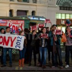 Group holds up Kony posters in Piccadilly Circus, KONY 2012 ÔCover The NightÕ London.