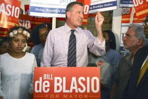 New York mayoral candidate Blasio, standing between his daughter Chaiara and district attorney candidate Thompson, speaks during a campaign rally in Brooklyn, New York