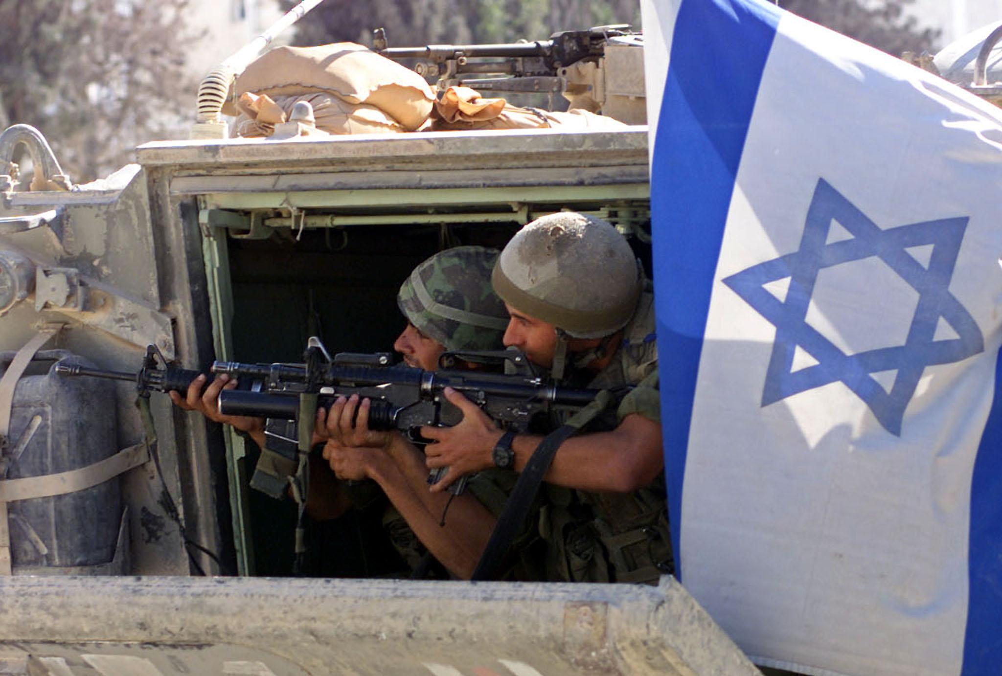 ISRAELI SOLDIERS PREPARE TO SHOOT TEARGAS GRENADES AT PALESTINIAN BOYS IN BETHLEHEM'S DEHEISHE REFUGEE CAMP